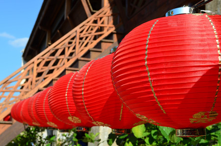 Hanging red Chinese lantern for festival and decoration, side view