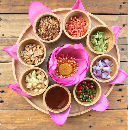 Traditional Thai snack called Miang Kham, savoury pink lotus petal wrapped Stock fotó - 115460560