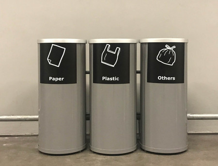 Modern metal cylinder trashcan or bin in public area or shopping mall or hotel or restaurant, recycle concept