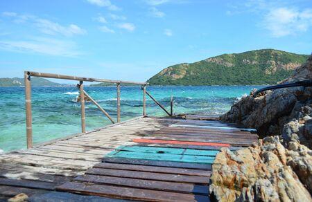 Wooden walkway on blue sea, selective focus