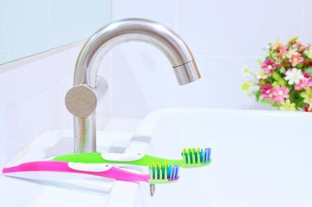Modern ceramic white wash basin with toothbrush - bathroom interior