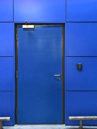 Blue door with modern yellow wall, architecture concept