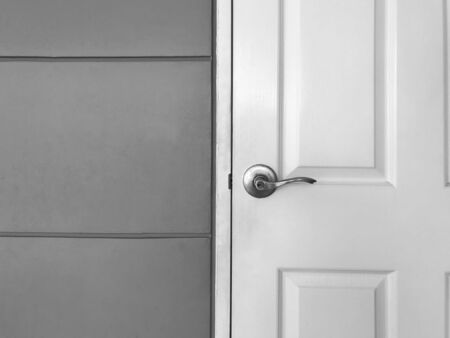 White close wooden door and gray cement wall, black and white tone 版權商用圖片