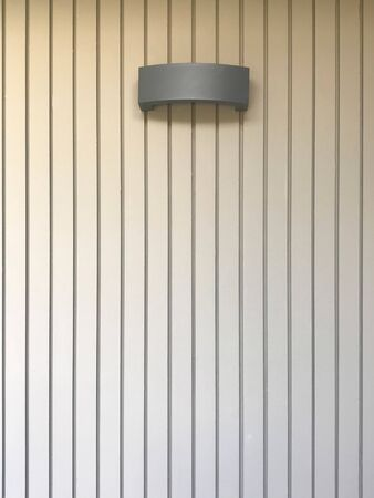 Black modern hanging lamp on stripe cement wall