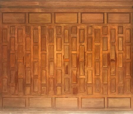 Ancient and contemporaryThai style of wooden wall panel for background and texture, architecture concept