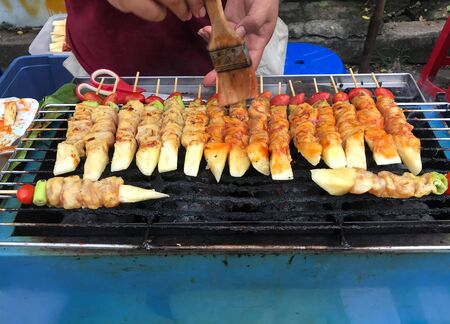 Grilld chicken bar-b-q or BBQ with tomato, pineapple and paprika in street food market Stok Fotoğraf
