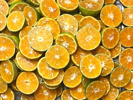 Pile of sliced fresh tangerine, top view