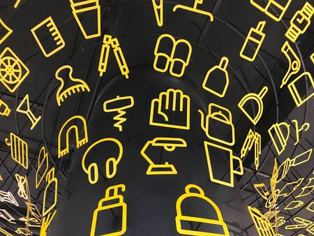 Yellow cut out metal in utensil and appliances shape decorate on black background Stok Fotoğraf