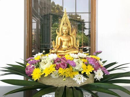 Golden buddha image with beautiful sacred flower Stok Fotoğraf
