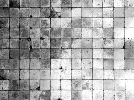 Ancient vintage cracked square tile wall or floor for background and texture, black and white tone