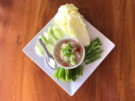 Traditional Thai food, crab or bean paste in white creamy coconut soup served with fresh vegetable, top view Stok Fotoğraf
