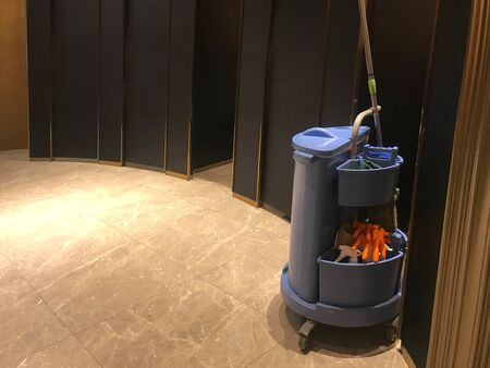 Blue cleaning tools service cart waiting for maid or cleaner in luxurious modern restroom of hotel or shopping mall or hospital Stok Fotoğraf