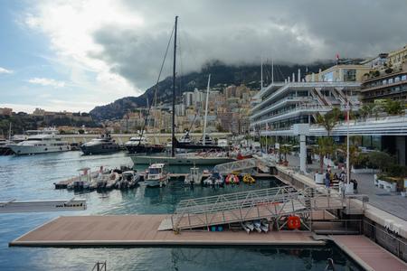 Monte Carlo port under the beautiful rain clouds Editorial