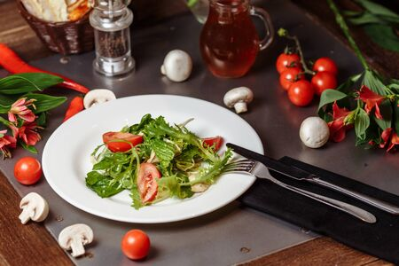 Caesar salad with chicken, cherry tomatoes, lettuce.