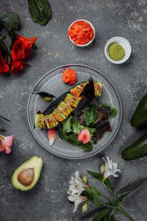 Japanese sushi -Green dragon. Avocado, onion, salmon and sushi cheese. Top view Zdjęcie Seryjne