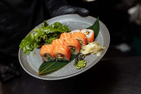 Philadelphia Maki Sushi made of Philadelphia Cream Cheese inside, Fresh Raw Salmon outside. Garnished with Sauce. 스톡 콘텐츠