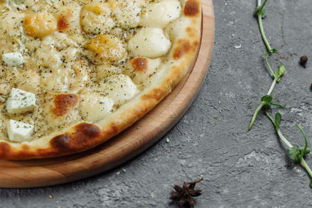 four cheese pizza, italian pizza. pizza stuffed with four varieties of cheese on a gray background Reklamní fotografie