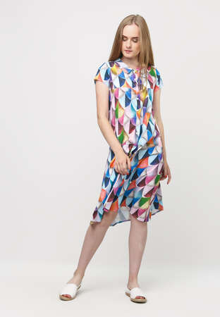 Full length of a young elegant girl in a summer dress, on a light background. advertising concept for clothing stores. Content for social networks and banners.
