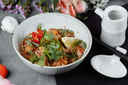 Thai rice with chicken and vegetables. place for inscription. 写真素材