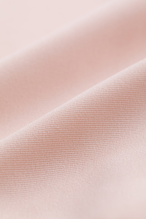 Close-up of salmon pink cloth 写真素材