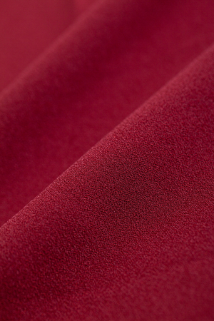 Close-up of chiffon material of wine red