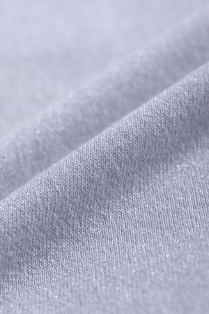 close up of Light gray knit material with lame