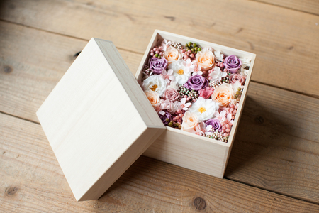 Close-up of pink preserved flower in a wooden box Stok Fotoğraf