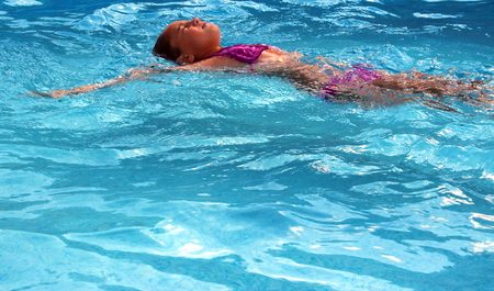 swimming costumes: little girl in the water