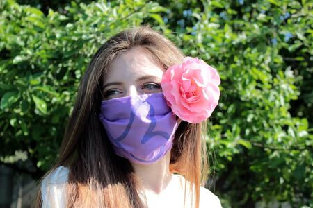 a beautiful girl with protection mask