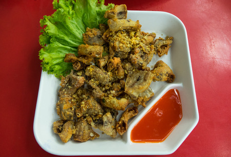 chitterlings: Chitterlings Fried garlic with hot chille sauce Thai food. Stock Photo