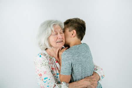 A grandmother and grandson on a studio white backdrop Standard-Bild