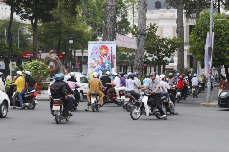 HANOI - JUNE 14  Unidentified riders ride motorbikes on busy road on June 14, 2010 in Hanoi, Vietnam  Motorbike is the most favorite vehicle for Hanoians, so Hanoi is always called the motorbike city
