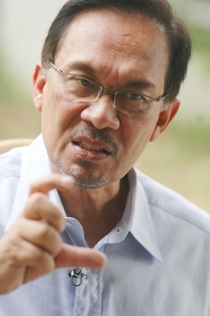KUALA LUMPUR - JAN 20   Malaysian opposition leader Anwar Ibrahim speaks during an interview with Press at his office in Kuala Lumpur on January 20, 2013