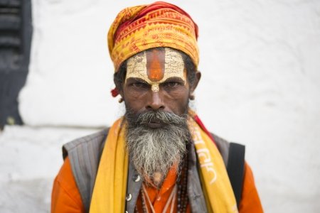 ascetic: KATHMANDU - JULY 22  Sadhu at Pashupatinath Temple in Kathmandu, Nepal on July 22, 2013  Sadhus are holy men who have chosen to live an ascetic life and focus on the spiritual practice of Hinduism