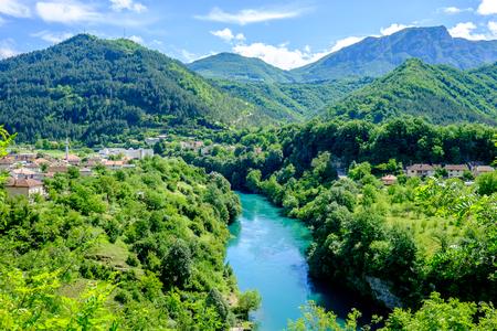 Azure brook flowing through the verdant countryside of Bosnia and Herzegovina 스톡 콘텐츠