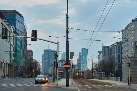 spire: Warsaw, Poland - March 28, 2016: Kasprzaka street, Office building Warsaw Spire under construction in Warsaw, Poland. Warsaw Spire is a modern landmark and a powerful symbol of Warsaws energy. The highest sustainable standards combined with comfortable an