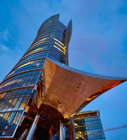 spire: Warsaw, Poland - March 28, 2016: Office building Warsaw Spire under construction in Warsaw, Poland. Warsaw Spire is a modern landmark and a powerful symbol of Warsaws energy.