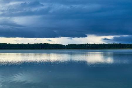 Dramatic Storm Clouds over Lemiet beautiful lake in Masuria district, Poland. Fantastic travel destination.