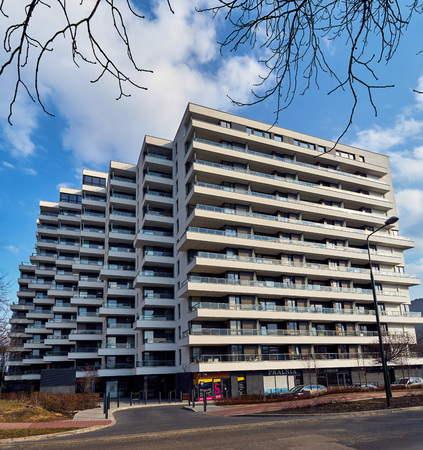 storey: Warsaw, Poland - March 05, 2017: Facade of a modern multi-storey residential building in Warsaw Editorial