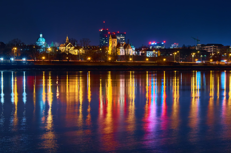 old center: Warsaw, Poland - March 21, 2017: Great panoramic night view of the center and the Old City of Warsaw - Stare Miasto - from the right bank of the Vistula River.
