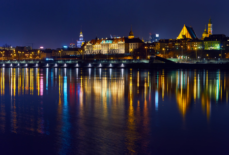 Warsaw, Poland - March 21, 2017: Great panoramic night view of the center and the Old City of Warsaw - Stare Miasto - from the right bank of the Vistula River.