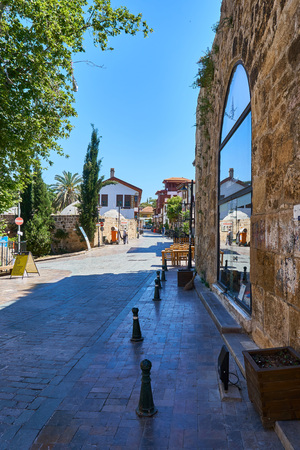 ANTALYA, TURKEY - MAY 21, 2017: Old street view in the Historic part of Antalya, Turkey. Old town of Antalya is a popular destination: The unique atmosphere of the old city attracts tourists from all over the world.