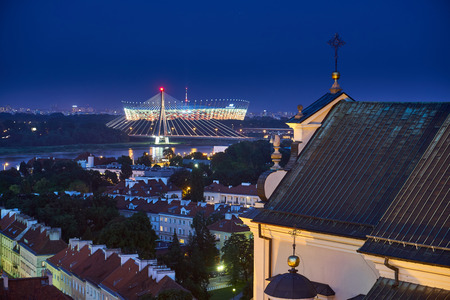 Warsaw, Poland - August 11, 2017: Beautiful aerial panoramic night view of Plac Zamkowy square in Warsaw, with historic building, including Sigismund III Vasa Column, and people at summer sunset, Warsaw, Poland. Krakowskie Przedmiescie is one of the best