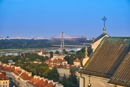 retractable: Warsaw, Poland - August 11, 2017: Beautiful panoramic view from old town of National Stadium (Polish: Stadion Narodowy) at summer sunset. The PGE Narodowy (official name since 2015) or National Stadium is a retractable roof football stadium located in War Editorial