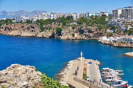 ANTALYA, TURKEY - MAY 21, 2017: Panoramic view on Old marina - most popular tourist place, cozy cafes, luxury restaurants, green park and landmarks in Antalya, Turkey.