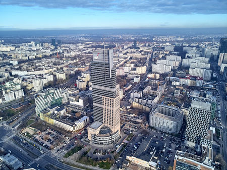WARSAW, POLAND - NOVEMBER 27, 2018: Beautiful panoramic aerial drone view to the center of Warsaw City and The Warsaw Trade Tower (WTT) - skyscraper along with the Palace of Culture and Science