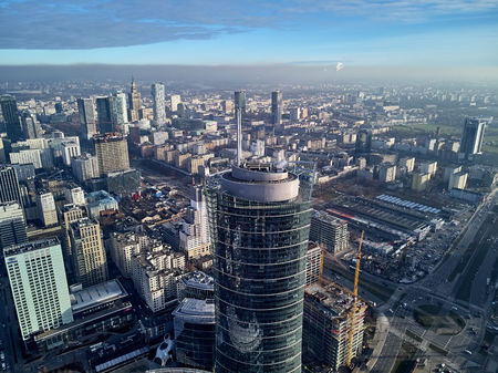 WARSAW, POLAND - NOVEMBER 27, 2018: Beautiful panoramic aerial drone view to the center of Warsaw City and The Warsaw Spire - 220 metre neomodern office building on European square (Plac Europejski) 報道画像