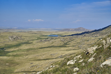 Beautiful panoramic summer steppe landscape of stone mountains