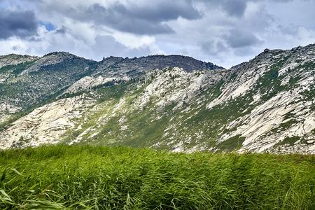 Beautiful landscape of stone rock mountains around of the Sibiny lakes (RU: Sibinskiye Ozora: Sadyrkol, Tortkara, Shalkar, Korzhynkol), neer the city of Oskemen (RU: Ust-Kamenogorsk), East Kazakhstan