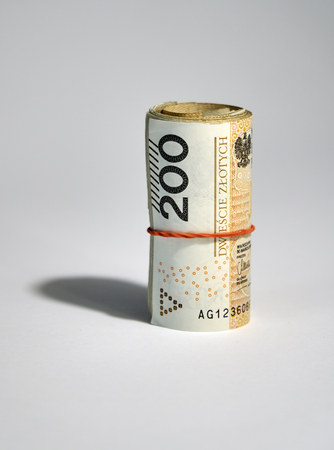 Rolled up polish money (PLN) - two hundred polish zloty bills isolated on a white background